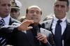 Лампедуза: Берлускони обещает освободить остров от беженцев и построить там кази