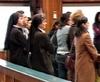 В зале суда монахини и священники.