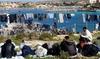 Нелегальных иммигрантов, прибывающих на территорию Италии из Северной Африки, ра