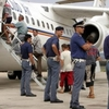 Высланные из Италии мигранты вернулись в приемный центр, потому что их самолет н